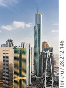 Купить «DUBAI, UAE - JAN 13, 2017: Almas Tower, Indigo Tower, Lake City Tower, Global Lake View, highway, Every year more than 55 million tourists visit Dubai», фото № 28212146, снято 13 января 2017 г. (c) Losevsky Pavel / Фотобанк Лори