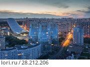 Купить «KRASNOGORSK, RUSSIA - JUN 8, 2015: Three moden house Sails - new Unique residential complex at sunset», фото № 28212206, снято 8 июня 2015 г. (c) Losevsky Pavel / Фотобанк Лори