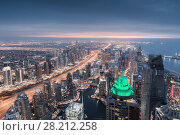 Купить «Dubai Marina area, Sheikh Zayed highway and sea shore during sunset, Dubai, UAE», фото № 28212258, снято 15 января 2017 г. (c) Losevsky Pavel / Фотобанк Лори