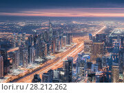 Купить «Skyscrapers of Dubai Marina area, Sheikh Zayed highway during sunset, Dubai, UAE», фото № 28212262, снято 15 января 2017 г. (c) Losevsky Pavel / Фотобанк Лори