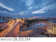 Купить «Serafimovich Street, Small stone bridge and Kremlin far away in Moscow evening, long exposure», фото № 28212314, снято 26 июня 2014 г. (c) Losevsky Pavel / Фотобанк Лори