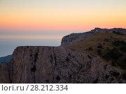 Купить «Picturesque big rock near sea shore at summer evening during sunset», фото № 28212334, снято 27 августа 2013 г. (c) Losevsky Pavel / Фотобанк Лори