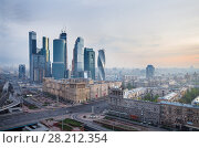 Купить «MOSCOW - MAY 3, 2014: Futuristic Moscow International Business Center at morning. Years of construction of complex - 1995-2018», фото № 28212354, снято 3 мая 2014 г. (c) Losevsky Pavel / Фотобанк Лори