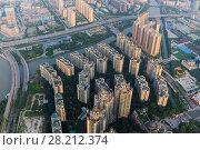 Купить «Residential area in modern Guangzhou city, Zhujiang river, China», фото № 28212374, снято 21 августа 2015 г. (c) Losevsky Pavel / Фотобанк Лори