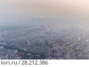 Купить «Big residential area in modern Guangzhou city in mist, China», фото № 28212386, снято 21 августа 2015 г. (c) Losevsky Pavel / Фотобанк Лори