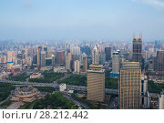 Купить «SHANGHAI - AUG 7, 2015: Tomorrow square among high buildings, 990 skyscrapers are in Shanghai», фото № 28212442, снято 7 августа 2015 г. (c) Losevsky Pavel / Фотобанк Лори