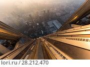 Купить «SHENZHEN, CHINA - AUG 26, 2015: Skyscraper wall (of Ping An Finance Centre) and morning cityscape», фото № 28212470, снято 26 августа 2015 г. (c) Losevsky Pavel / Фотобанк Лори
