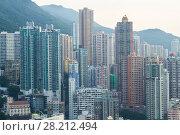 Купить «Modern tall residential buildings in sleeping area near mountain in Hong Kong, China, view from China Merchants Tower», фото № 28212494, снято 30 августа 2016 г. (c) Losevsky Pavel / Фотобанк Лори