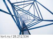 Купить «Inside top of crane on skyscraper under construction in clouds», фото № 28212534, снято 10 августа 2015 г. (c) Losevsky Pavel / Фотобанк Лори