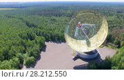 Купить «MOSCOW - JUL 25, 2015: TNA 1500 antenna of radio telescope RT-64 Bear Lakes near forest at summer sunny day. Aerial view», фото № 28212550, снято 25 июля 2015 г. (c) Losevsky Pavel / Фотобанк Лори