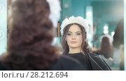 Купить «Professional hairstylist making wedding hairstyle», видеоролик № 28212694, снято 25 апреля 2018 г. (c) Константин Шишкин / Фотобанк Лори
