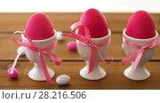 Купить «easter eggs in holders and candies on table», видеоролик № 28216506, снято 15 марта 2018 г. (c) Syda Productions / Фотобанк Лори