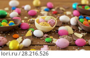 Купить «chocolate easter eggs and drop candies on table», видеоролик № 28216526, снято 15 марта 2018 г. (c) Syda Productions / Фотобанк Лори