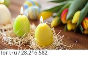 Купить «candles in shape of easter eggs and flowers», видеоролик № 28216582, снято 15 марта 2018 г. (c) Syda Productions / Фотобанк Лори