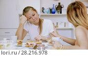 Купить «Young girl is comforting her sad girlfriend at her home.», видеоролик № 28216978, снято 17 октября 2017 г. (c) Яков Филимонов / Фотобанк Лори