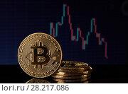 Купить «Bitcoin with a chart. Cryptocurrency.», фото № 28217086, снято 17 марта 2018 г. (c) Мельников Дмитрий / Фотобанк Лори