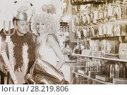 Купить «Cheerful couple trying on helmet with horns», фото № 28219806, снято 11 апреля 2017 г. (c) Яков Филимонов / Фотобанк Лори
