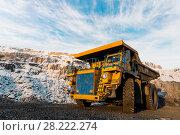 Купить «Large quarry dump truck. Loading the rock in dumper. Loading coal into body truck. Production useful minerals. Mining truck mining machinery, to transport coal from open-pit as the Coal Production.», фото № 28222274, снято 30 января 2018 г. (c) Сергей Тимофеев / Фотобанк Лори