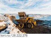 Купить «Large quarry dump truck. Loading the rock in dumper. Loading coal into body truck. Production useful minerals. Mining truck mining machinery, to transport coal from open-pit as the Coal Production.», фото № 28222278, снято 30 января 2018 г. (c) Сергей Тимофеев / Фотобанк Лори