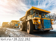 Купить «Large quarry dump truck. Loading the rock in dumper. Loading coal into body truck. Production useful minerals. Mining truck mining machinery, to transport coal from open-pit as the Coal Production.», фото № 28222282, снято 30 января 2018 г. (c) Сергей Тимофеев / Фотобанк Лори