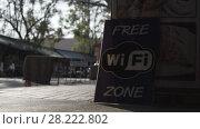 Купить «Free wi-fi poster street asian peoples cars bikes sign, symbol», видеоролик № 28222802, снято 23 марта 2018 г. (c) Aleksejs Bergmanis / Фотобанк Лори