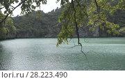 Купить «Tropical Thai jungle lake, island, wild mountains nature national park ship yacht rocks», видеоролик № 28223490, снято 23 марта 2018 г. (c) Aleksejs Bergmanis / Фотобанк Лори