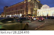 Купить «Christmas and New Year holidays illumination and Four Seasons Hotel at night. Moscow. Russia», видеоролик № 28224410, снято 25 марта 2018 г. (c) Владимир Журавлев / Фотобанк Лори