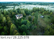 Купить «Abandoned farm in the Chernobyl Exlusion Zone, Ukraine September», фото № 28225078, снято 21 сентября 2018 г. (c) Nature Picture Library / Фотобанк Лори