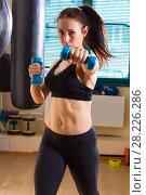 Купить «Woman boxer in time of workout», фото № 28226286, снято 21 марта 2018 г. (c) Владимир Мельников / Фотобанк Лори