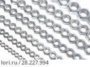 Купить «Metal nuts of different sizes», фото № 28227994, снято 5 февраля 2015 г. (c) Юрий Бизгаймер / Фотобанк Лори