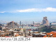 Yerevan, Armenia - March 18, 2018: Modern and soviet buildings. stadion Hrazdan against mountains, Yerevan, Armenia. Редакционное фото, фотограф Papoyan Irina / Фотобанк Лори