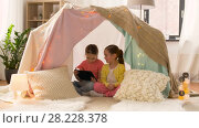 Купить «little girls with tablet pc in kids tent at home», видеоролик № 28228378, снято 23 февраля 2018 г. (c) Syda Productions / Фотобанк Лори
