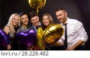 Купить «happy friends with golden and violet balloons», видеоролик № 28228482, снято 7 марта 2018 г. (c) Syda Productions / Фотобанк Лори