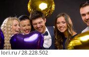 Купить «happy friends with golden and violet balloons», видеоролик № 28228502, снято 7 марта 2018 г. (c) Syda Productions / Фотобанк Лори