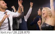 Купить «happy friends dancing at party or disco», видеоролик № 28228870, снято 7 марта 2018 г. (c) Syda Productions / Фотобанк Лори