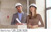 Купить «architects with blueprint and helmets at office», видеоролик № 28228926, снято 14 марта 2018 г. (c) Syda Productions / Фотобанк Лори