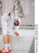 Купить «Rear view of teenage fencer in white clothes on the fencing tournament», фото № 28229070, снято 26 марта 2018 г. (c) Константин Шишкин / Фотобанк Лори