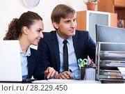 Купить «two happy employees in office», фото № 28229450, снято 16 января 2019 г. (c) Яков Филимонов / Фотобанк Лори