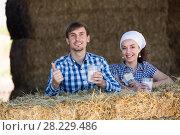 Купить «man and woman in hay with milk», фото № 28229486, снято 22 марта 2019 г. (c) Яков Филимонов / Фотобанк Лори