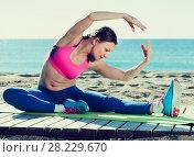 Купить «Ordinary healthy female stretching muscles», фото № 28229670, снято 6 мая 2017 г. (c) Яков Филимонов / Фотобанк Лори