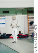 Купить «Young participant of the fencing tournament with rapier in hand ready for fight», фото № 28234678, снято 26 марта 2018 г. (c) Константин Шишкин / Фотобанк Лори