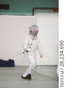 Купить «Boy teenager fencer in special costume at the fencing competition with rapier ready for fight», фото № 28234690, снято 26 марта 2018 г. (c) Константин Шишкин / Фотобанк Лори