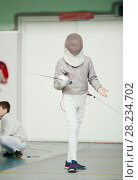 Купить «Boy teenager fencer in special costume at the fencing competition with rapier in fighting position», фото № 28234702, снято 26 марта 2018 г. (c) Константин Шишкин / Фотобанк Лори