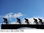 Купить «Скульптура велосипедисты в альпах», фото № 28234798, снято 28 января 2015 г. (c) Скалдина Мария / Фотобанк Лори