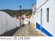 Купить «Cozy narrow paved streets with white houses inside the old city walls of Mertola. Beja. Portugal», фото № 28238054, снято 30 июня 2016 г. (c) Serg Zastavkin / Фотобанк Лори