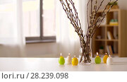 Купить «willow and candles in shape of easter eggs at home», видеоролик № 28239098, снято 28 марта 2018 г. (c) Syda Productions / Фотобанк Лори