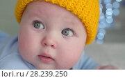 Купить «Baby with grey eyes», видеоролик № 28239250, снято 28 марта 2018 г. (c) Илья Шаматура / Фотобанк Лори