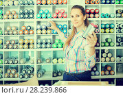 Купить «portrait of woman choosing paint color in aerosol can in art shop», фото № 28239866, снято 12 апреля 2017 г. (c) Яков Филимонов / Фотобанк Лори