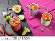 Купить «portions of tomato gazpacho in cups», фото № 28241550, снято 19 марта 2018 г. (c) Oksana Zh / Фотобанк Лори