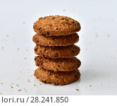 Купить «stack of oatmeal cookies on light background and crumbs», фото № 28241850, снято 29 марта 2018 г. (c) Володина Ольга / Фотобанк Лори